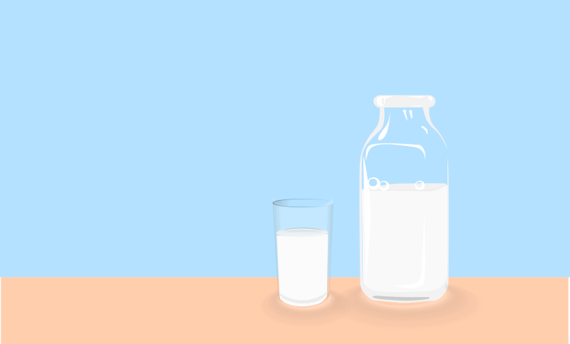 Bottle of milk and glass of milk on table