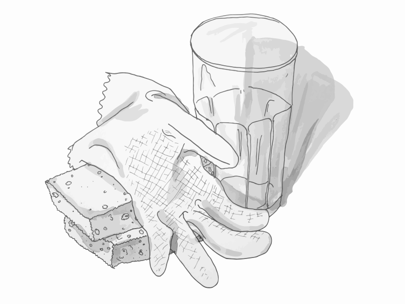 Sponges, plastic glove and a mug