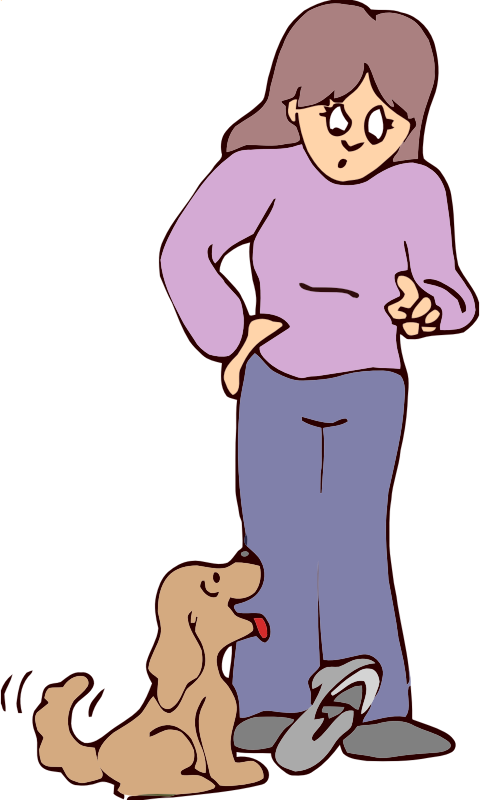 woman scolding dog