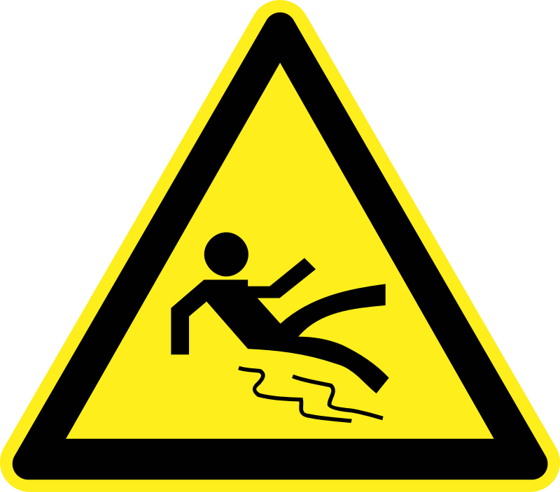 Wet and Slippery Warning Sign by h0us3s - Yellow triangular wet and slippery warning sign.