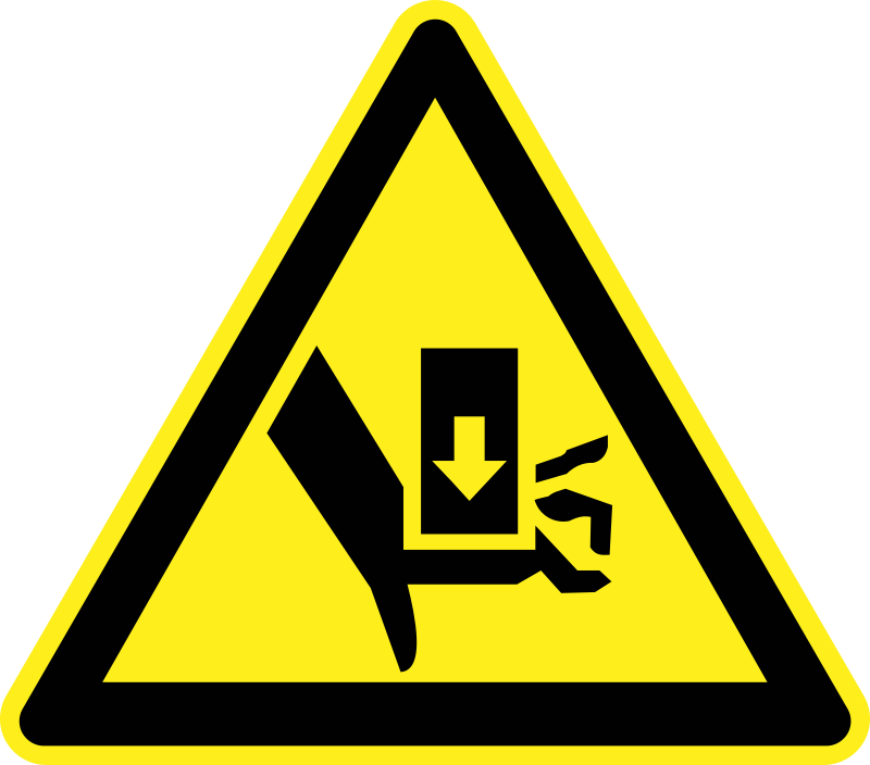 Crush Hazard Warning Sign by h0us3s - Yellow triangular crush hazard warning sign.