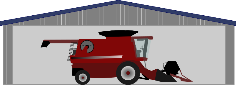 Combine harvester in shed by tmjbeary - A combine harvester in a shed.