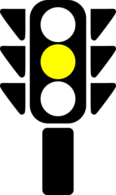 Traffic semaphore yellow light by laobc - A silhouette of a traffic semaphore with its yellow light on.