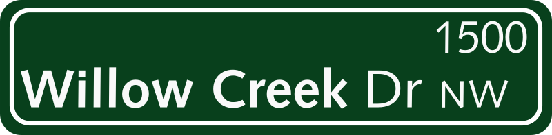 Green Street Sign by missiridia - A typical North American style street name sign; loosely corresponds to the 2009 USDOT standard with larger mixed-case letters.