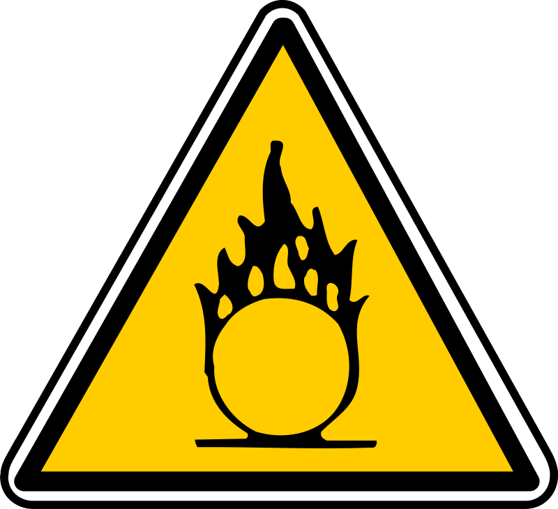 warning by yves_guillou - Triangular warning sign for combustible materials.
