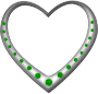 Silver heart studded with emeralds